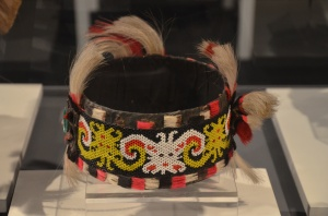 This headdress is worn by the women of Dayak Kenyah. It is decorated by yellow and white beads in the motif of ancestral spirits. It is also decorated with white horse hair at the top.